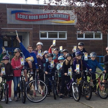 A group of École Robb Road Elementary students actively travel to and from school via bicycle