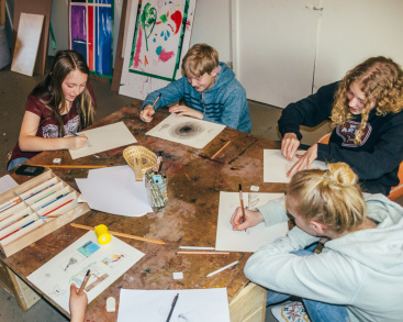 Teenagers in Tofino participate in an art class.